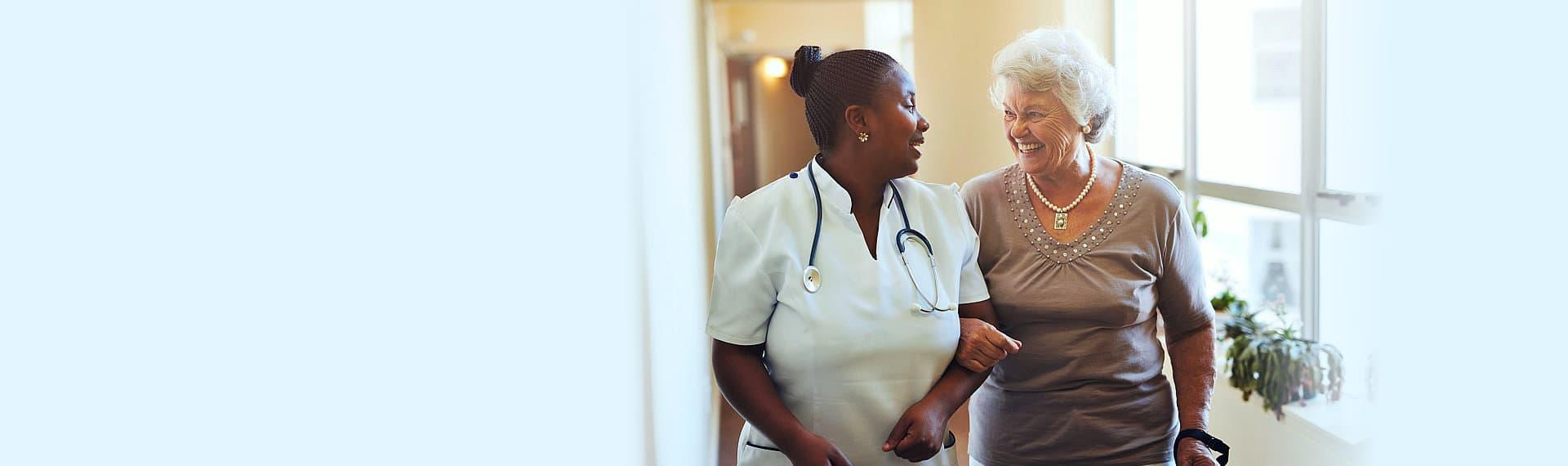 nurse and senior woman laughing